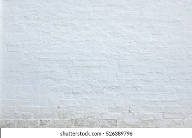 Old White Washed Brick Wall Abstract Horizontal Background Texture Or Studio Backdrop. Home Or Loft Design Element In Modern Vintage Style