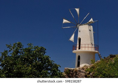 An old white wind mill in Greece