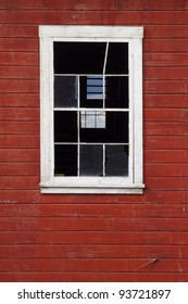 Old white window on red wall