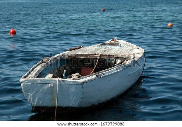 old-white-wooden-boat-sea-600w-167979908