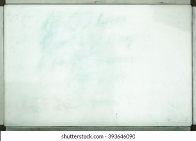 Old whiteboard for office with traces of stains and spots