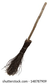 Old wicked broom isolated on white . witch's broomstick. A besom or more commonly known as the witches broomstick .It was often utilized in the magical practices of the Middle Ages