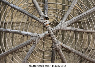 Old wicker canopy against the wall background