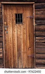old wild west jail door with small window