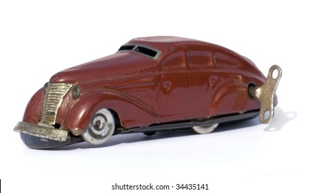 Old wind up car. Isolated on white.