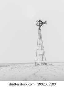 Old wind mill in winter on the prairies,.