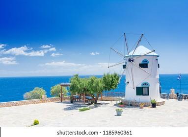 Old Windmill in Agios Nikolaos near blue caves in Zakynthos (Zante) island, in Greece -