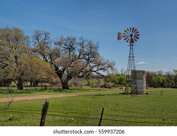 Old windmill in a cattle pasture in west Texas with water tank for the cattle