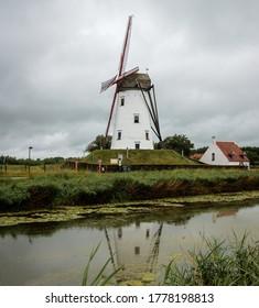 Old windmill in Damme, Belgium known as Hoeke Mill (Hoekemolen)