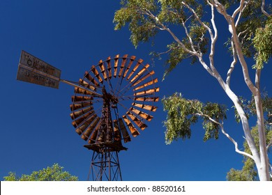 Old Windmill with Ghost gum tree in the Australian Outback