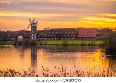 Old windmill near Caldecotte Lake at beautiful sunset