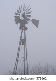 Old windmill on a foggy day