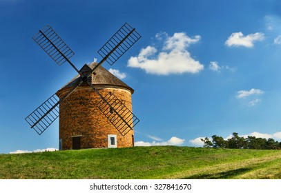 Old windmill on the green hill in a sunny day