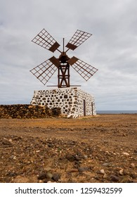 Old windmill preserved at the seaside of island Fuerteventura, Spain.