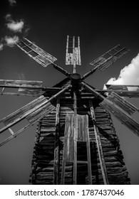 Old windmill. Ukrainian mill of the nineteenth century. Summer landscape, sunshine. Village Pirogovo.