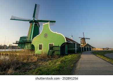 old windmills in Holland at sunset