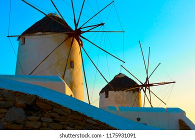 Old windmills in Mykonos island at sundown, Greece