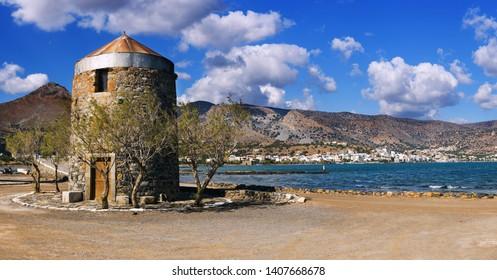 Old Windmills Poros Elounda at Spinalonga Peninsula near the town of Elounda, Island of Crete - Greece