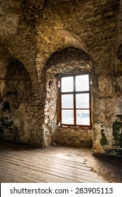 Old window of an abandoned house. Inside the old castle