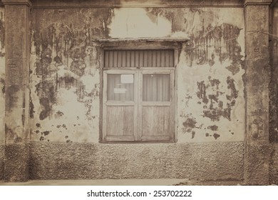Old window at ancient building in China town Bangkok, Thailand