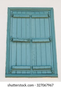 Old window with blue shutters. Background.