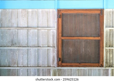 Old window with cage on white wooden wall.