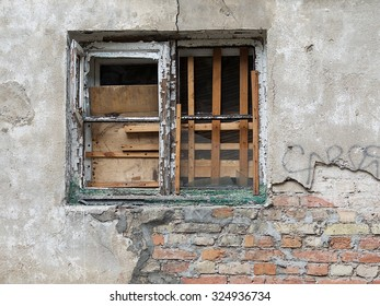 Old window, exterior of old house, Old aged building fragment, destroyed house, stylized picture with selective focus. Ruined building. No people. Aged building. Vintage photo.