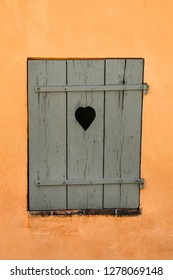 Old window with heart in St Tropez