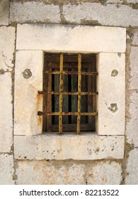 Old window with metal grids as architecture detail