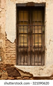 Old Window on cracked and worn wall in Guanajuato Mexico