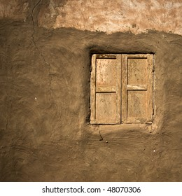 Old window on mud wall in oasis town, Egypt