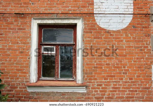 old-window-on-red-brick-600w-690921223.j