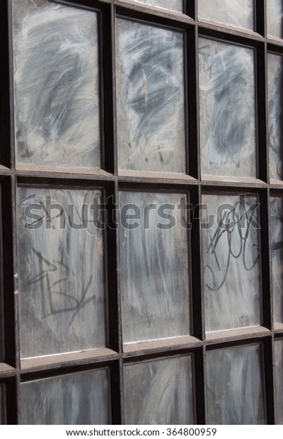 old window panes with graffiti and scratches