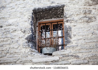 old window and rocky wall