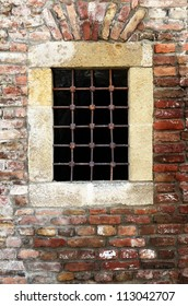 Old window with rusty bars