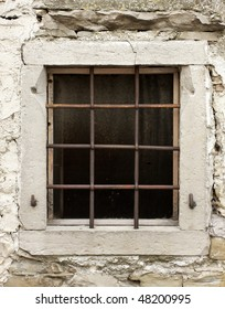 Old window with rusty iron bars
