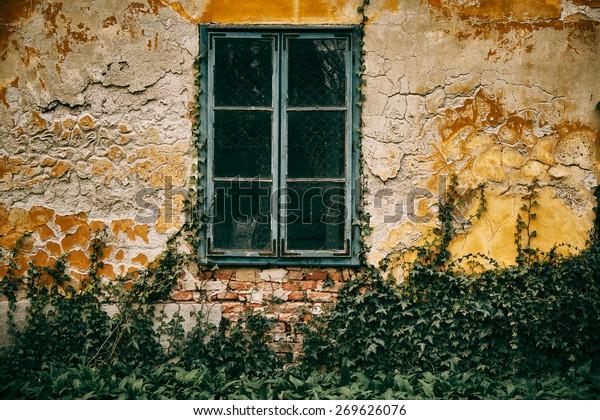 Old window rusty wall