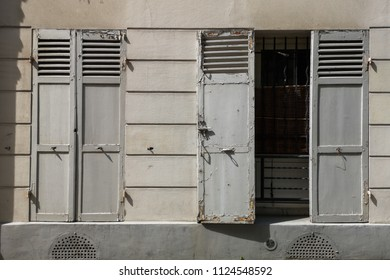 Old window shutter, open and closed shutters, old europe concept
