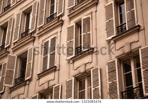 Old window shutters on an European apartment building, in an architectural background