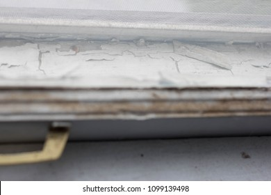 old window sill with chipped paint antique glass with rope pully