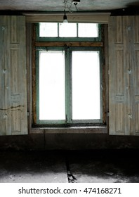 old window with spider webs in an abandoned room. vintage