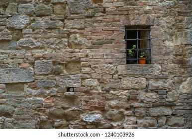 Old window in stone wall