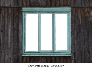 The old window of the old wooden log house