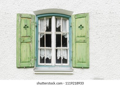 Old window with wooden shutters on a residential home in Germany