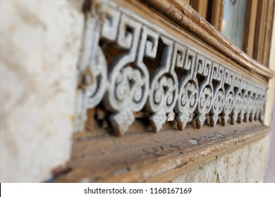 Old window with wrought iron floral ornaments.