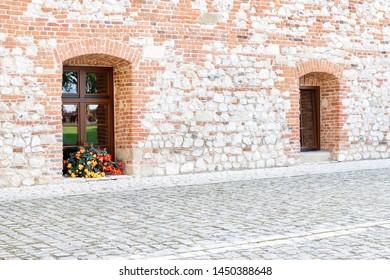 Old windows in brick wall.