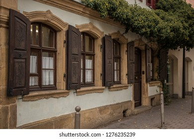 Old windows made of stone and wood with brown shutters