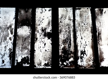 Old windows on an abandoned ironwork creating a nice background
