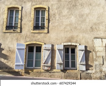 Old windows with shutters on the old house in town