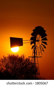 Old windpump with sun directly behind stearer